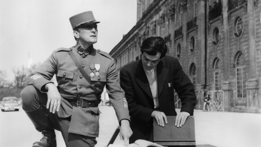 """Kirk Douglas, left, and director Stanley Kubrick, on the set of """"Paths of Glory"""" in 1957."""