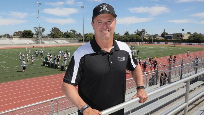 Brad Hollingsworth, the new athletic director at Oceanside High School, attends football practice at the school's John Carroll Stadium.