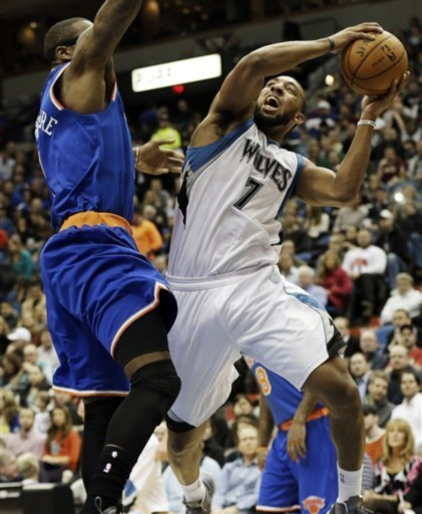 Minnesota Timberwolves' Derrick Williams, right, attempts a layup as New York Knicks' Amar'e Stoudemire defends in the first period of an NBA basketball game Friday, Feb. 8, 2013 in Minneapolis. (AP Photo/Jim Mone)