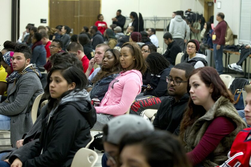 In this March 24, 2015 photo, University of Maryland students listen to speakers during a town hall meeting about racism in universities and what can be done to stop it, at University of Maryland in College Park, Md. Conversations like the one at Maryland's Nyumburu Cultural Center are taking place nationwide as racist incidents continue to pop up at colleges and universities, even though students are becoming increasingly vocal in protesting racism and administrators are taking swift, zero-tolerance action against it. (AP Photo/Jose Luis Magana)
