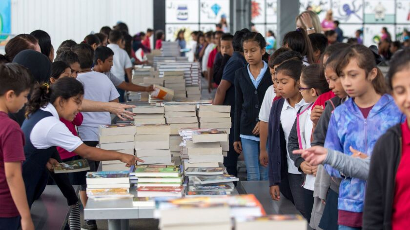 Whittier Elementary School students line up to choose from among thousands of donated books on Monda