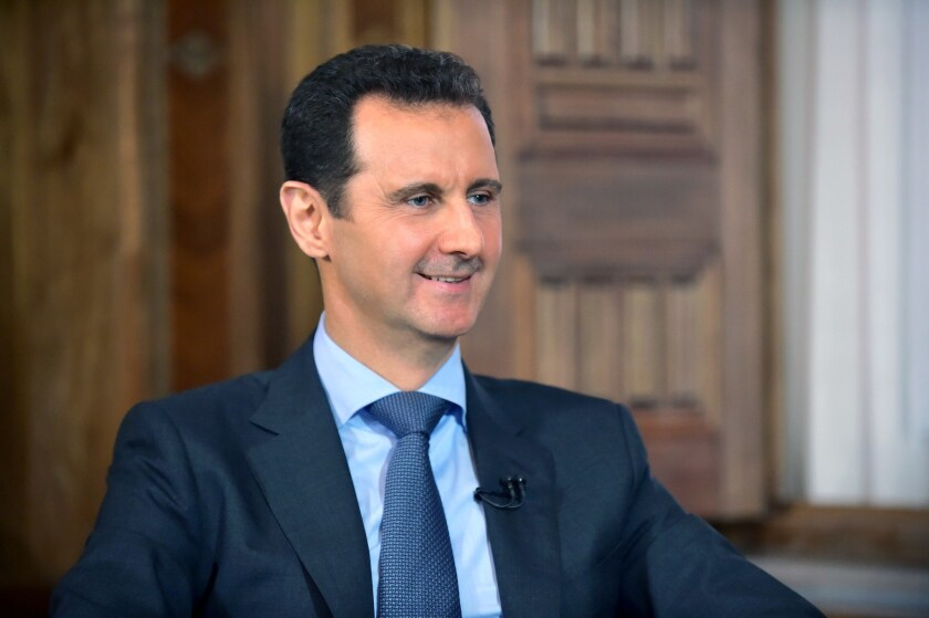 Syrian President Bashar Assad is seen answering questions during an August interview in Damascus in a picture released by the official Syrian Arab News Agency.