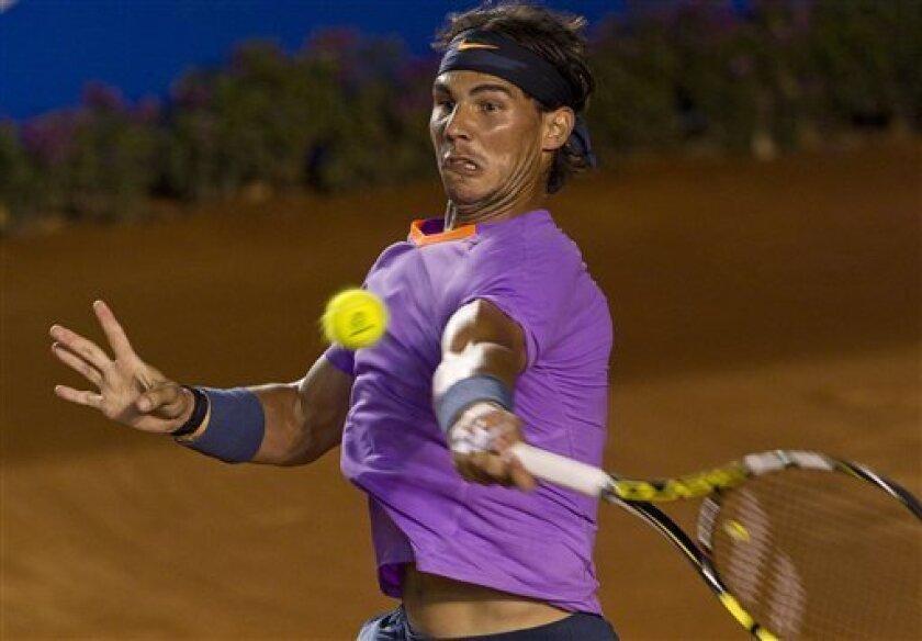Spain´s Rafael Nadal returns the ball to Argentina´s Leonardo Mayer during a Mexican Open tennis game in Acapulco, Mexico, Thursday, Feb.  28, 2013. (AP Photo/Christian Palma)