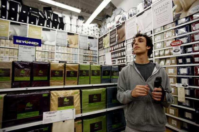 Daniel Gordon, then 18, shops for his freshman year using a scanner at Bed Bath and Beyond in Los Angeles in 2010. The company is buying Cost Plus for $495 million.