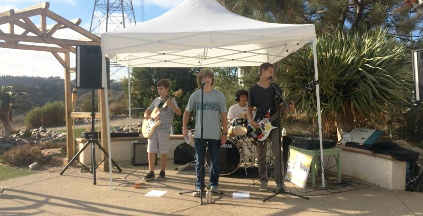 The Elements performing at the Agua Hedionda Lagoon in Carlsbad on July 10. Band members (l-r): Ryan Beck, guitarist, Julian Boyer, lead vocalist, Dylan Herrera, drummer, and Granger Pasko, guitarist.