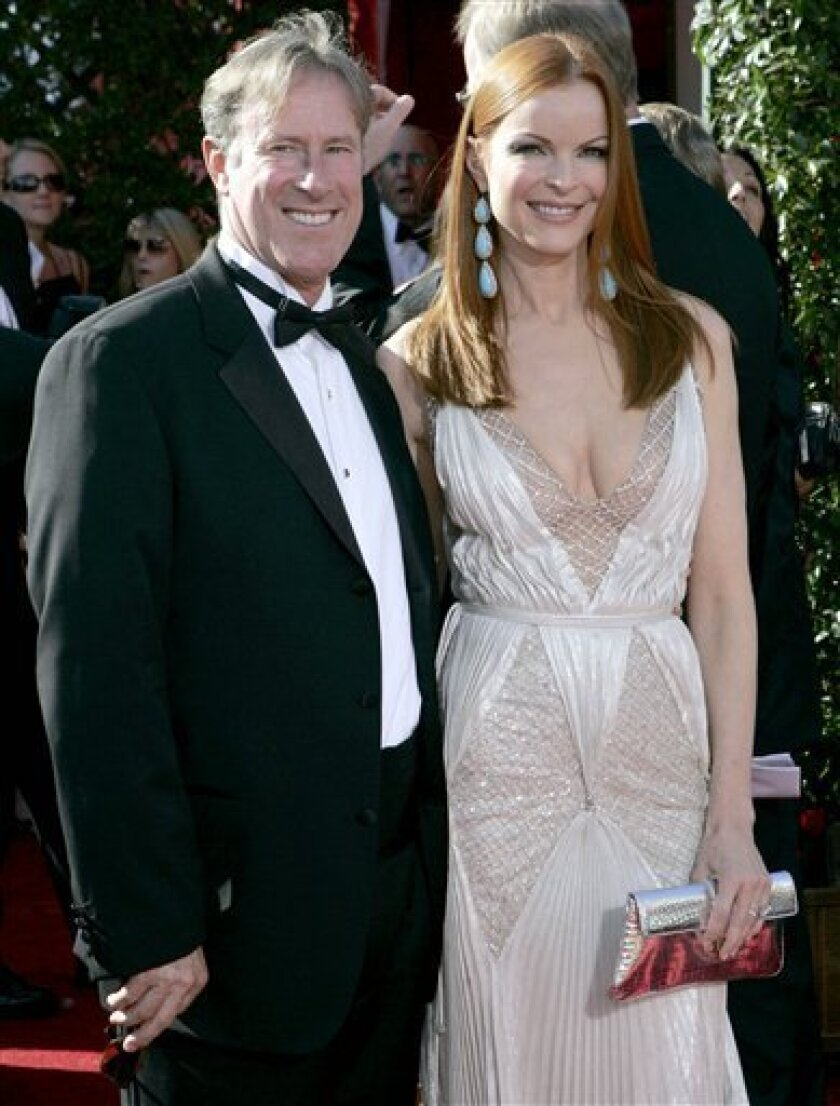 """In this Sept. 16, 2007 file photo, Marcia Cross, a star from the series """"Desperate Housewives,"""" and her husband Tom Mahoney arrive for the 59th Primetime Emmy Awards at the Shrine Auditorium in Los Angeles. (AP Photo/Chris Carlson, file)"""
