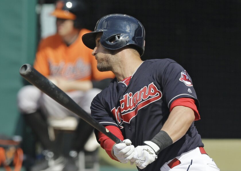 Cleveland Indians' Yan Gomes hits a two-run single off Baltimore Orioles starting pitcher Ubaldo Jimenez in the first inning of a baseball game, Saturday, May 28, 2016, in Cleveland. Mike Napoli and Jose Ramirez scored on the play. (AP Photo/Tony Dejak)