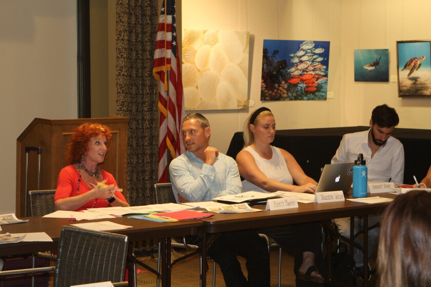 The La Jolla Village Merchants Association (shown: Jodi Rudick, Brett Murphy, Jessica Wiley and Benoit Roux) meets 3 p.m. second Wednesdays in the Community Room at La Jolla Library.
