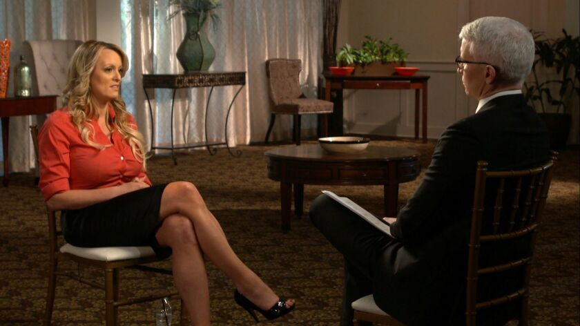 "Stormy Daniels, left, is interviewed by Anderson Cooper on CBS' ""60 Minutes"" Sunday night."