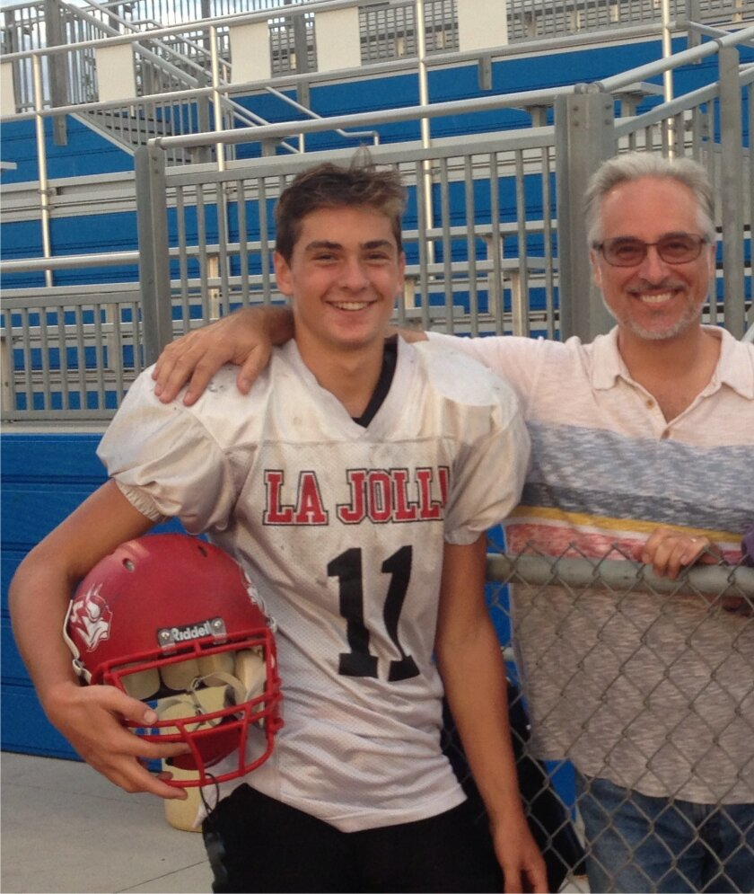 Stephen Hayden, a professor of emergency medicine at UC San Diego, and his son, Kenny, a freshman quarterback at La Jolla High School. Note: Kenny is not the player who was injured during a game last fall.