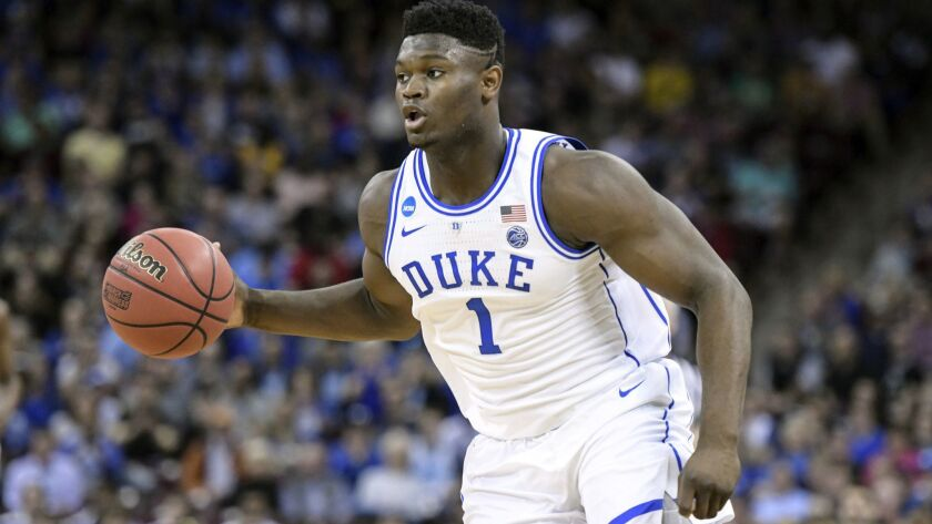 FILE - In this March 24, 2019, file photo, Duke forward Zion Williamson (1) dribbles the ball agains