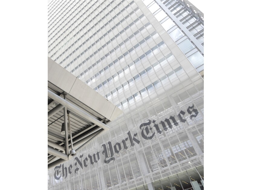 """FILE - This June 22, 2019 file photo shows the exterior of the New York Times building in New York. An editor and writer for The New York Times' opinion section has publicly resigned, saying she was harassed for ideas that didn't conform with a liberal point of view. Bari Weiss was one of two journalists to quit jobs Tuesday while alleging that """"woke"""" culture is crowding out dissenting points of view. Andrew Sullivan, a conservative columnist at New York magazine, also said he was leaving. (AP Photo/Julio Cortez, File)"""