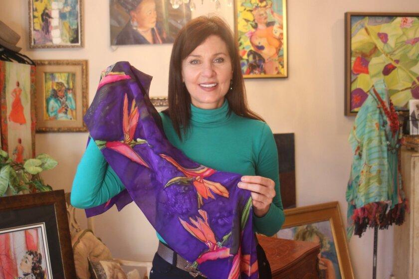 La Jolla Art Association Vice President Judy Judy Judy shows off some of her wearable art.