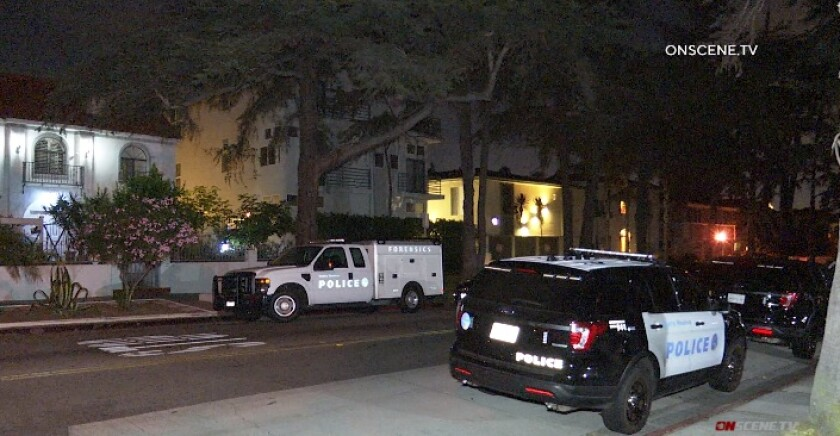 Homicide investigators from the Santa Monica Police Department at the scene of a fatal shooting late Sunday.