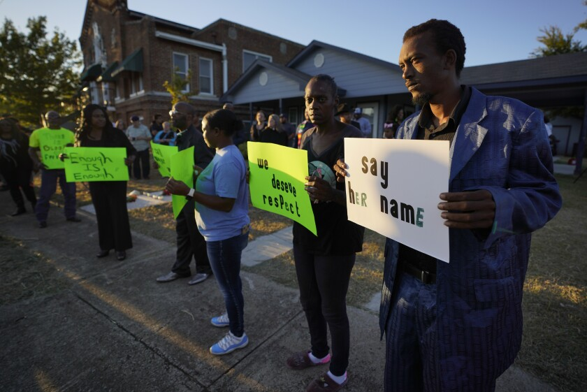 Protesters gather on Sunday outside the house where Atatiana Jefferson was killed by police in Forth Worth.