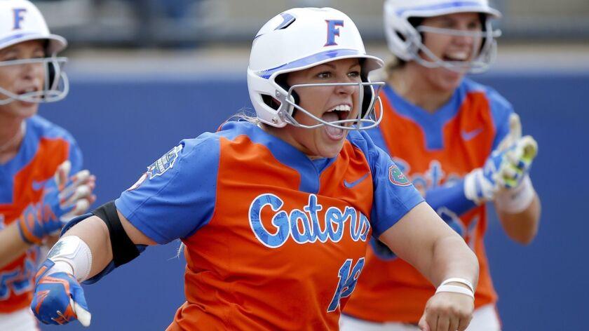 Florida's Amanda Lorenz (18), Justine McLean (52) and Nicole DeWitt (23) celebrate a score in the se