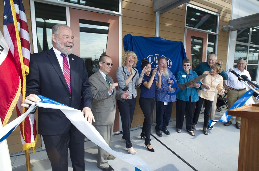 City and school officials including OCC President Dennis Harkins, left, and Costa Mesa Mayor Katrina Foley, third from left, celebrate the new OCC Recycling Center with a dedication and ribbon-cutting ceremony at the new center on Thursday.