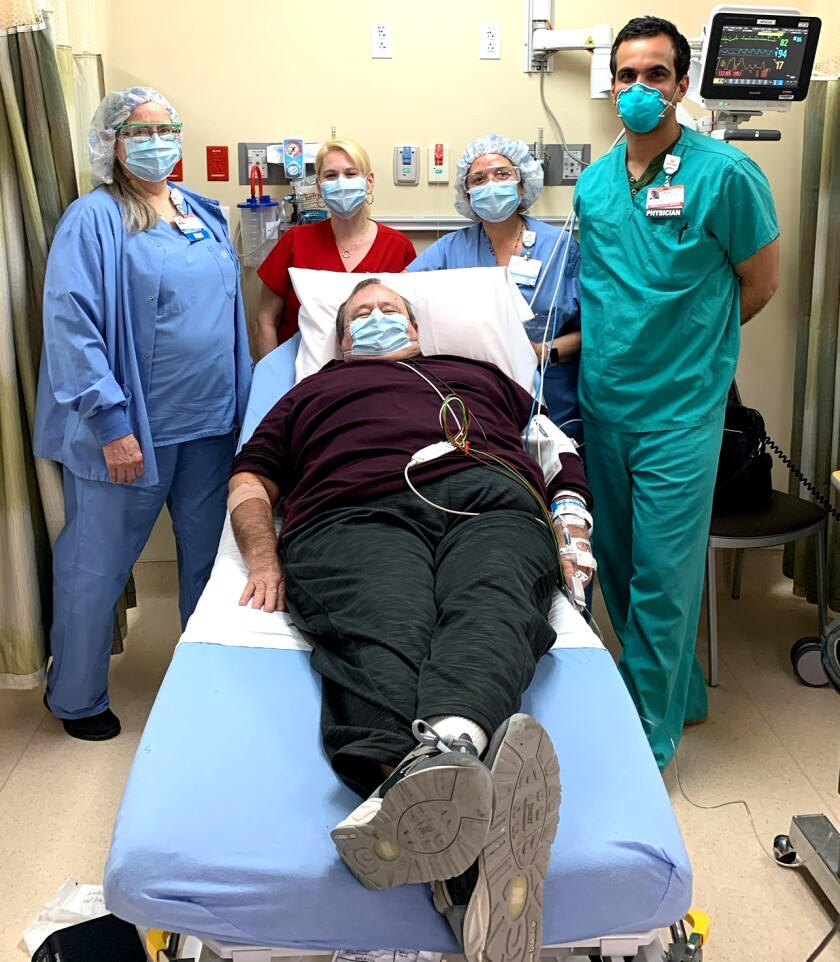 Dwight Everett, a recovered COVID-19 patient, awaits his blood draw at St. John's Pleasant Valley Hospital in Camarillo. Plasma from the 65-year-old retired electrician went to Ron Shirley, an 80-year-old retired gas company planner who was being ravaged by the same disease.