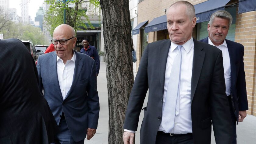 Rupert Murdoch, left, leaves a Manhattan restaurant on Monday with Fox News co-presidents Jack Abern