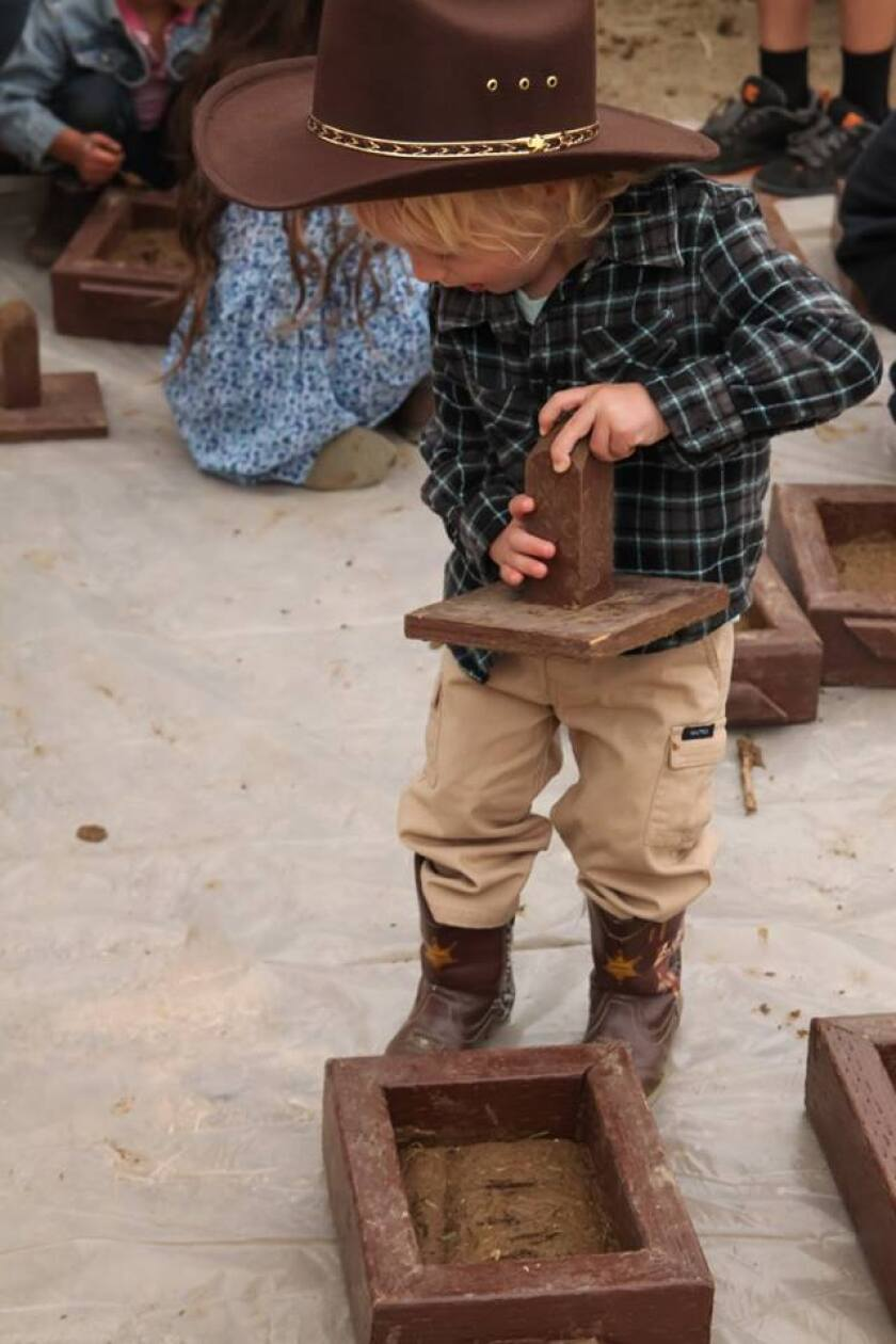 A young brickmaker at last year's celebration. (photo by Carly Ealey)