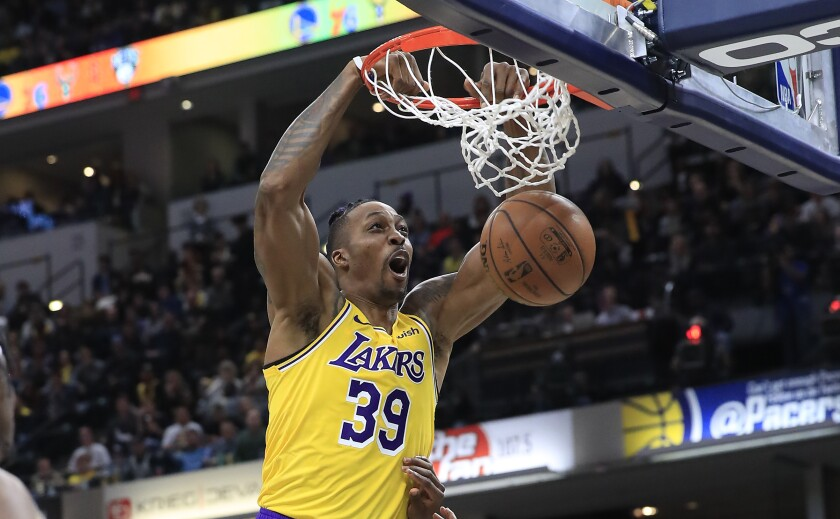 Lakers center Dwight Howard dunks during a game against the Indiana Pacers.
