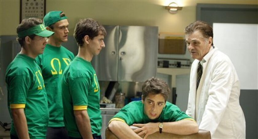 """In this publicity image released by TBS, Fred Willard, right, guest stars with cast members, from left, Drew Seeley, Harley Sawyer, Kelly Blatz and Matt Bush in a scene from """"Glory Daze."""" (AP Photo/TBS, Trae Patton)"""