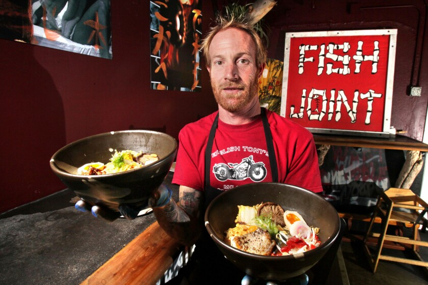 Chef Davin Waite, owner of The Whet Noodle, holds two of his ramen noodle creations.