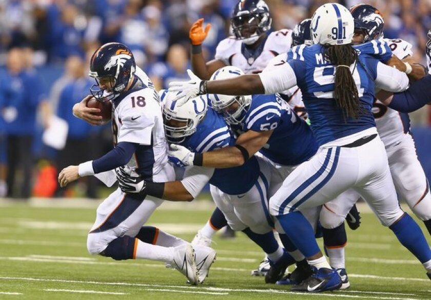 Peyton Manning of the Denver Broncos is sacked during Sunday's game against the Indianapolis Colts.