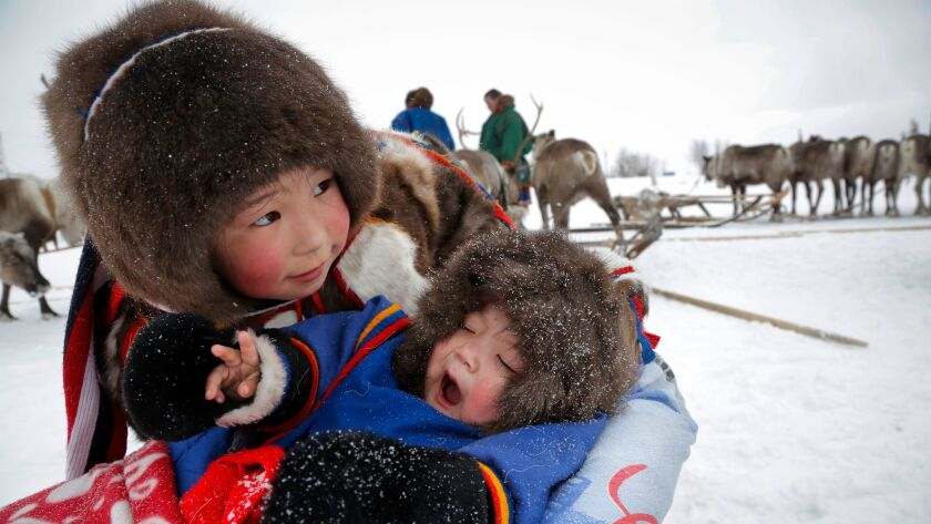 Children of the indigenous nomadic Nenets people in the city of Nadym in Russia's northeast region,