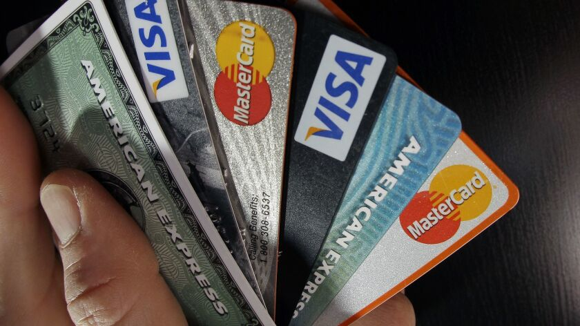 FILE - In this March 5, 2012 file photo, consumer credit cards are posed in North Andover, Mass. Ch