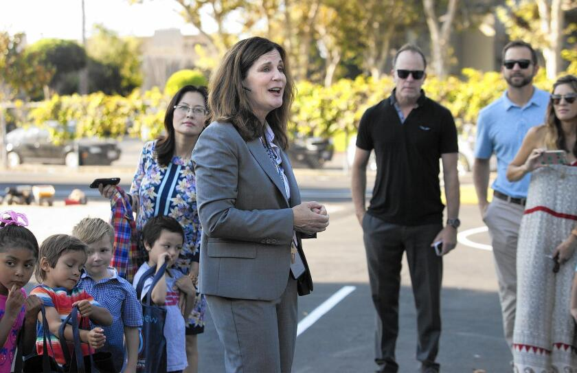 Laura Sacks, who at the time was serving her first day of school as principal of Mariners Elementary in Newport Beach, introduces herself to children and parents Sept. 8. She will not return to Mariners next school year.
