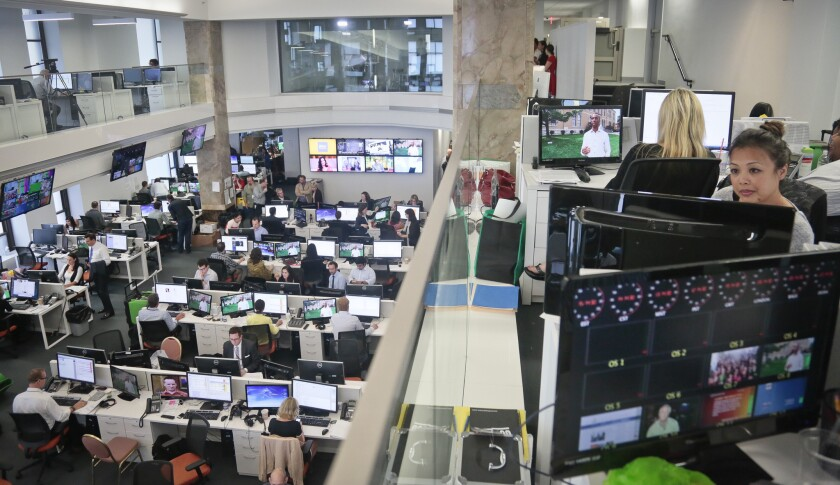 Staffers work in the Al Jazeera America newsroom after the network's first broadcast in New York. The Qatar-based Al Jazeera Media Network issued a statement in response to a complaint filed by prior owners of Current TV, former Vice President Al Gore and his business partner Joel Hyatt.