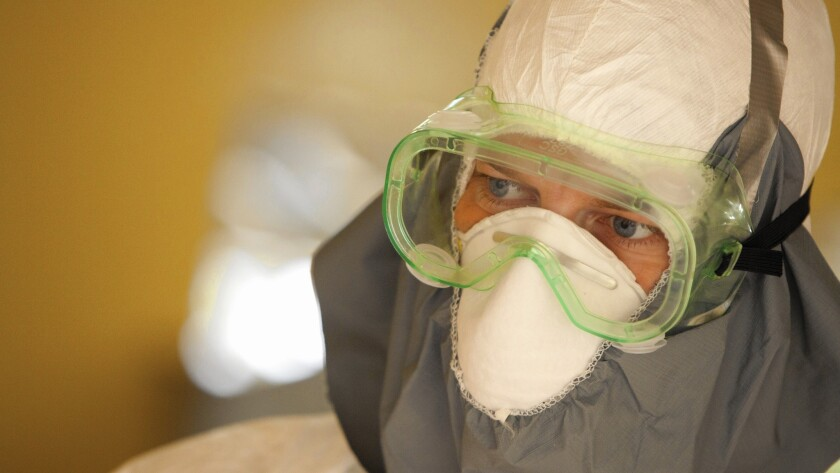 """Dr. Kent Brantly treats Ebola patients in Liberia. """"Ebola is a humiliating disease"""" for patients and health workers, he said."""