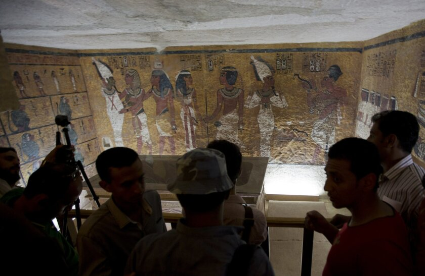 Foreign diplomats and Egyptologists attend the opening of an exact replica of the Tomb of Tutkankhamun in Luxor , Egypt. Wednesday, April 30, 2014. The replica aimsto help preserve the original, more than 3,300-year-old tomb from deterioration caused by tourist visitors. (AP  Photo/Khalil Hamra)