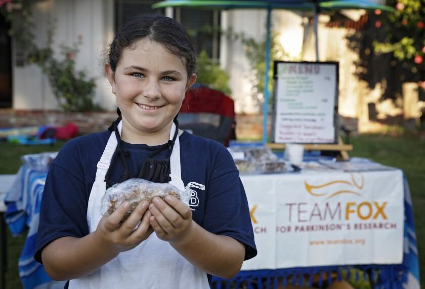 Zoe Bernard of La Mesa, age 9, at her bake sale for Parkinson's disease research on Sept. 5.