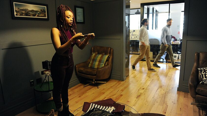 HOLLYWOOD-CA-OCTOBER 28, 2014: Khairah Cook, left, an intern with Hollywood Closet Rentals, takes ph