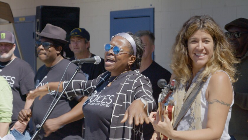 "Diane, center, performs with a homeless choir in the documentary ""The Homeless Chorus Speaks."""