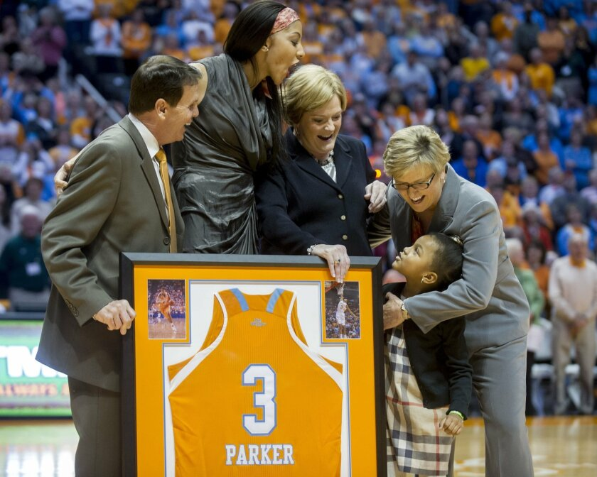 From left, Tennessee athletic director Dave Hart, former Tennessee player Candace Parker, former coach Pat Summitt and current coach Holly Warlick are greeted by Parker's daughter, Lailaa Williams, during the ceremony retiring Parker's jersey number before Tennessee's NCAA college basketball game against LSU on Thursday, Jan. 2, 2014, in Knoxville, Tenn. (AP Photo/Knoxville News Sentinel, Saul Young)
