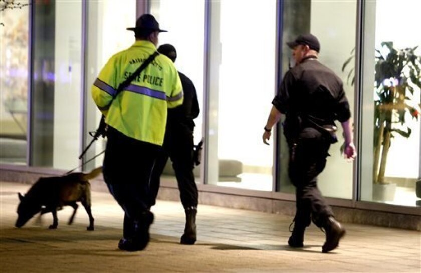 Officials patrol an area at Massachusetts Institute of Technology following reports of a shooting, Thursday, in Boston. State police say a campus police officer at the school has died from injuries in a shooting on the campus outside Boston.