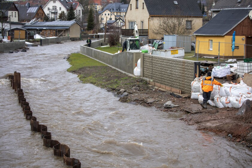 Melting snow and continuous rain have caused the levels of the river Zwoenitz in Burkhardtsdorf, Germany, Thursday, Feb. 4, 2021. (Bernd Maerz/dpa via AP)
