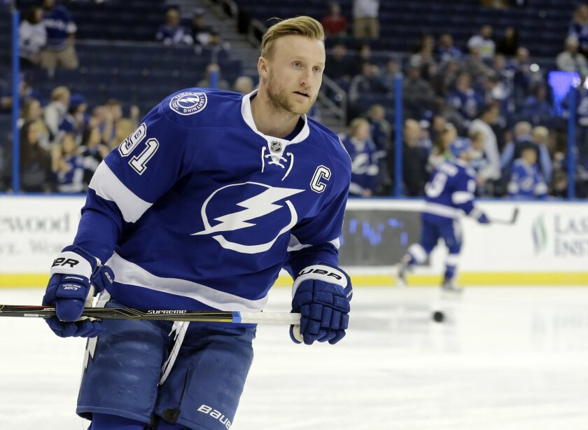 FILE - In this Jan. 15, 2016, file photo, Tampa Bay Lightning center Steven Stamkos (91) skates before an NHL hockey game against the Pittsburgh Penguins, in Tampa, Fla. Tampa Bay Lightning general manager Steve Yzerman says he won't trade captain Steven Stamkos before the Feb. 29 trade deadline. (