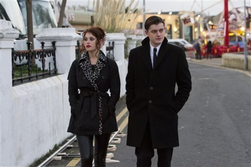 """This film image released by IFC Films shows Gemma Arterton, left, and Sam Riley in a scene from """"Byzantium."""" (AP Photo/IFC Films, Patrick Redmond)"""