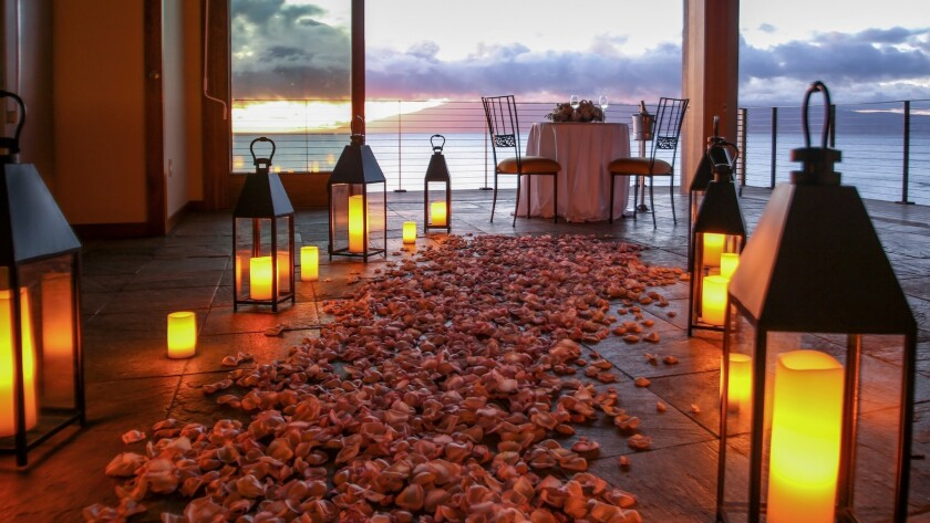A path of rose petals leads the way to waiting Champagne at the Cliff House at the Montage resort on Maui, where $20,000 will buy you an epic marriage proposal.
