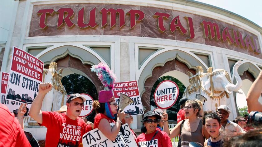 Striking workers picket outside the Trump Taj Mahal hotel and casino in Atlantic City, N.J. on July 6.