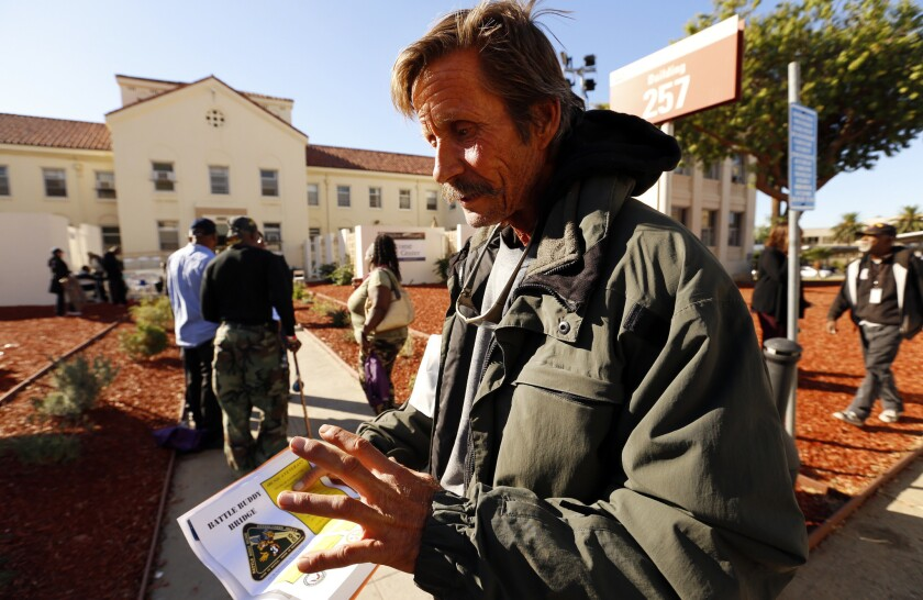 A homeless veteran attends the VA's Homeless-to-Housed Veteran's Stand Down event on Nov. 4, 2015 at the Veteran's Center in West Los Angeles.