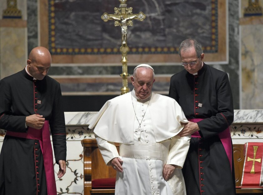 Pope Francis is helped down a set of steps during the midday prayer from the Liturgy of Hours, the daily form of prayer of the Catholic Church, with bishops from the U.S., Wednesday, Sept. 23, 2015, at the Cathedral of St. Matthew the Apostle in Washington. (AP Photo/Susan Walsh)