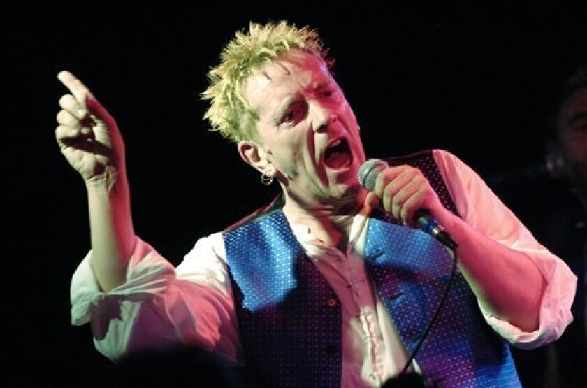 """FILE - This is a Thursday, Oct. 25, 2007 file photo of John Lydon as performs with The Sex Pistols at the Roxy in West Hollywood, Calif., The concert marked the legendary British punk band's first-ever club performance in Southern California. A 70-year-old song is giving the BBC a headache, as it decides whether to play """"Ding Dong! The Witch is Dead"""" _ a song from the """"Wizard of Oz"""" being driven up the charts by opponents of Margaret Thatcher as a mocking memorial to the late prime minister,"""