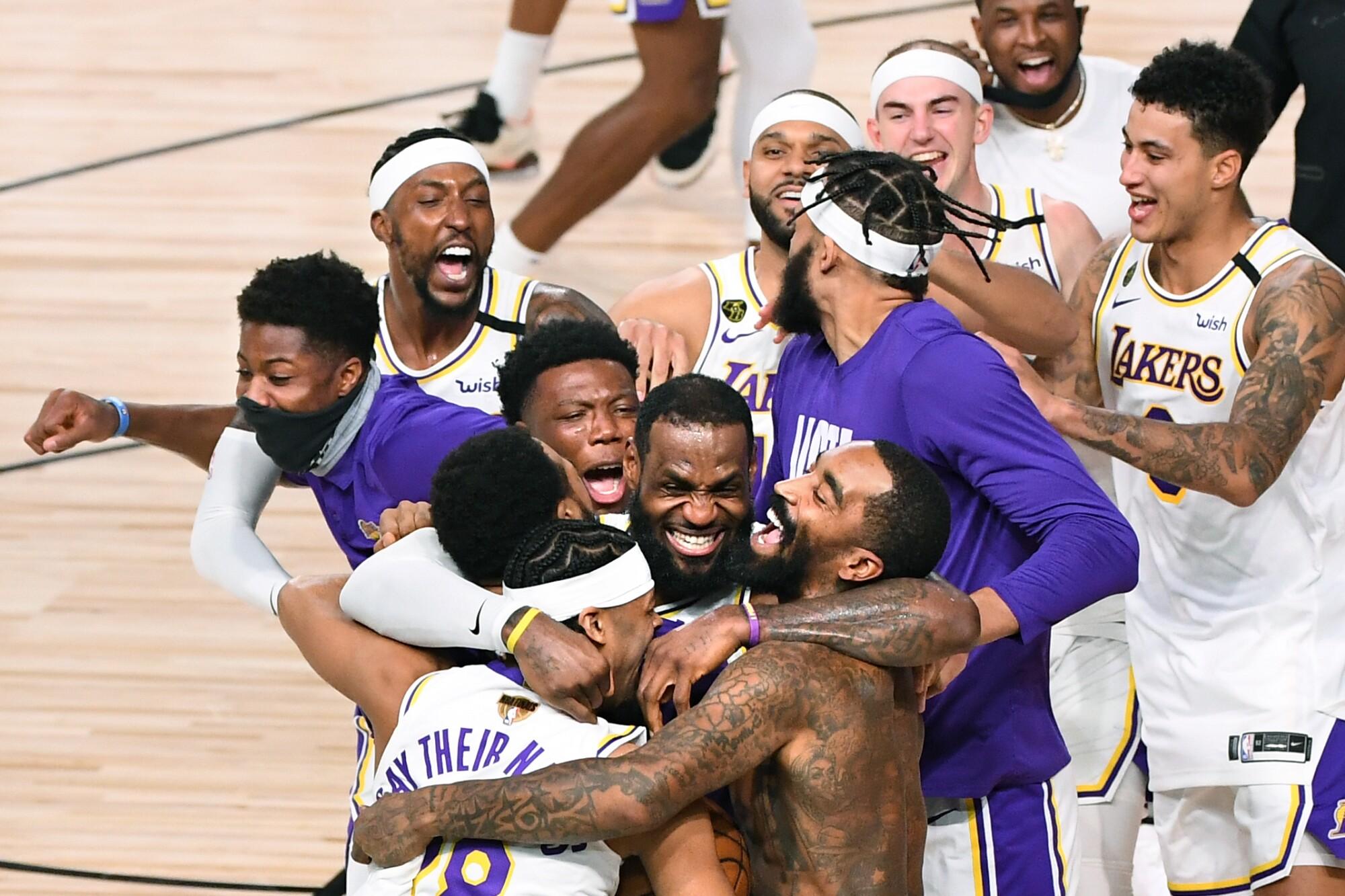 Laker players, including LeBron James, celebrate winning the NBA championship.