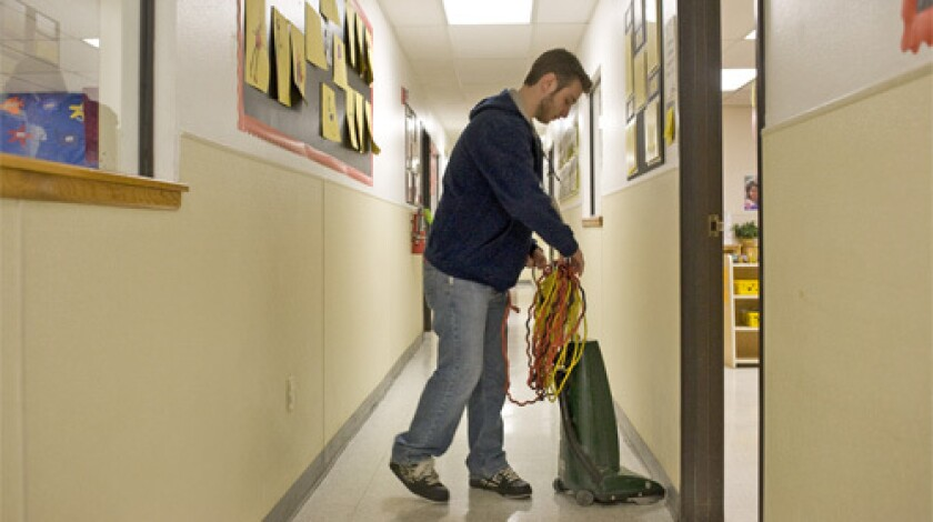 STRUGGLING: Brian Schreiber, a senior education major at the University of New Mexico, works as a janitor until 1 a.m. most nights, cleaning day-care centers to send money home.