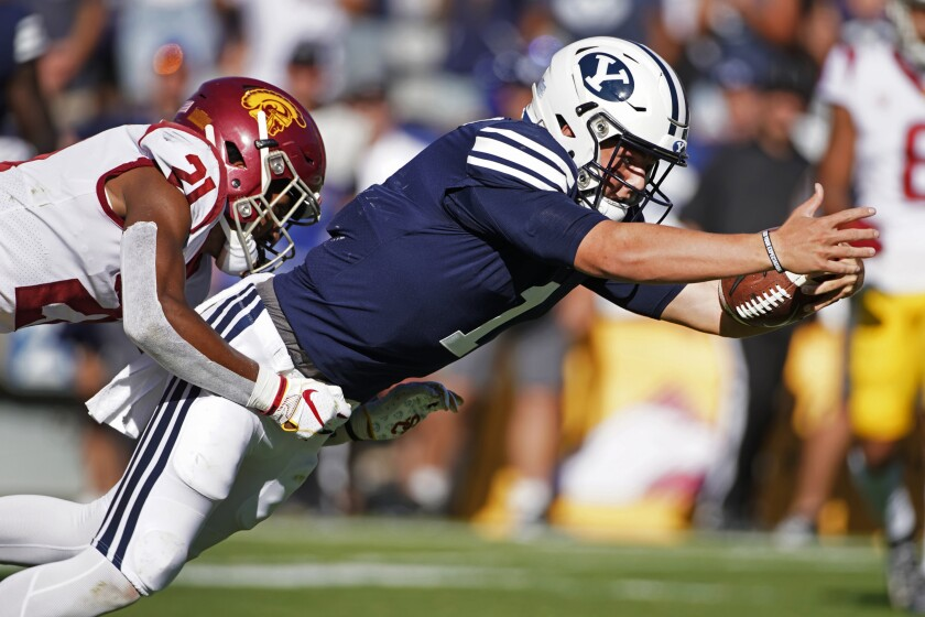 BYU quarterback Zach Wilson dives into the end zone for a touchdown.